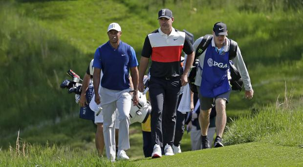 Brooks Koepka left Tiger Woods in his wake after an opening 63 at Bethpage (AP Photo/Julio Cortez)