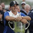 Brooks Koepka poses with the Wanamaker Trophy after winning the US PGA Championship (AP Photo/Julio Cortez)
