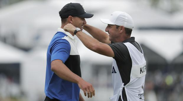 Brooks Koepka celebrates with his caddie Ricky Elliott after winning the US PGA Championship (AP Photo/Julio Cortez)