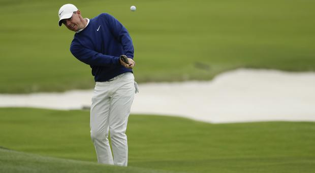 Rory McIlroy has made a solid start to the US Open (Matt York/AP)