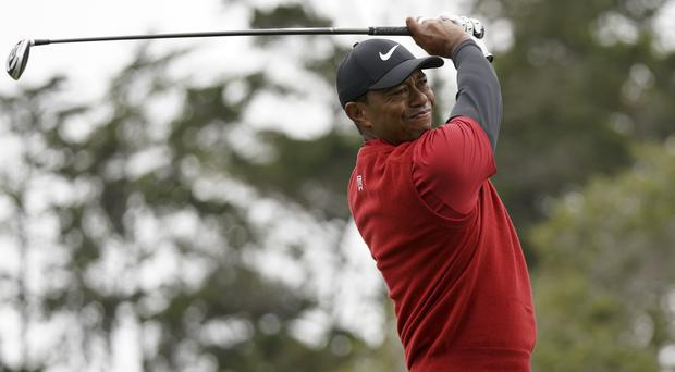 Tiger Woods carded his lowest score of the week during the final round at Pebble Beach (Carolyn Kaster/AP)