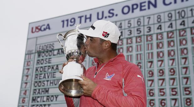 Gary Woodland posses with the trophy after winning the US Open at Pebble Beach (AP Photo/Carolyn Kaster)