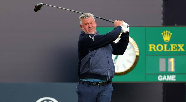 Darren Clarke hits the opening tee shot of the 2019 Open (Richard Sellers/PA)