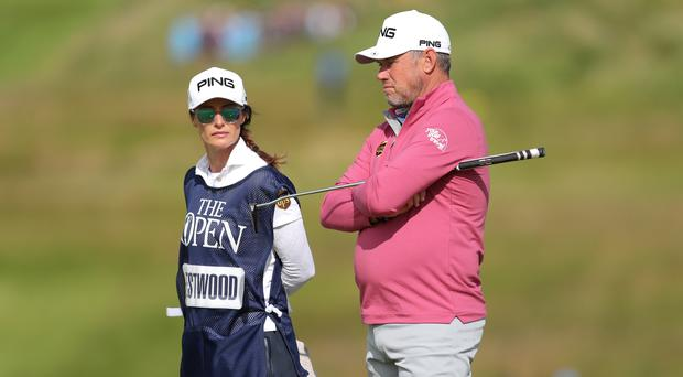 England's Lee Westwood, right, with girlfriend and caddie Helen Storey at the Open (Richard Sellers/PA)