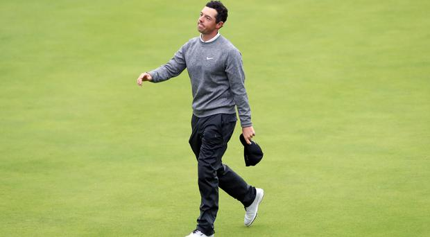Rory McIlroy's Open Championship came to an end, despite a valiant second-round fightback (David Davies/PA).