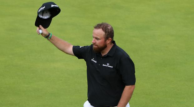 Shane Lowry takes a four-shot lead into the final round of the Open (Niall Carson/PA)