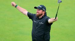 All smiles: Shane Lowry hails his Open triumph at Royal Portrush
