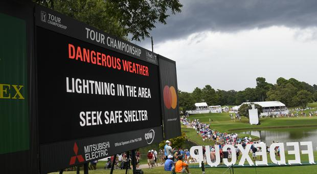 The Tour Championship had already seen play delayed by bad weather before Saturday's lightning strikes in Atlanta. (John Amis/AP)