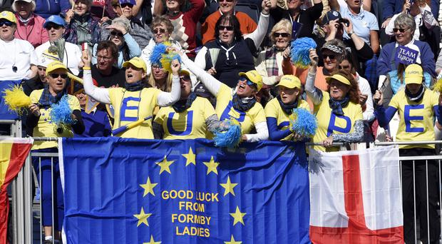 Team Europe fans in the stands on the first tee (Ian Rutherford/PA)
