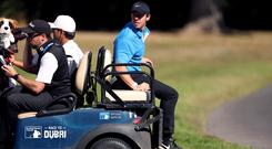 Rory McIlroy needed a ride back to the 18th tee after a wayward drive in the BMW PGA Championship (Bradley Collyer/PA)