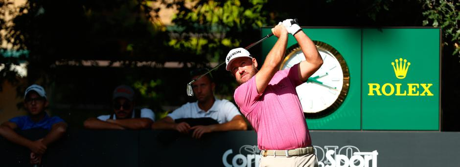 Looking up: Graeme McDowell is among chasing pack