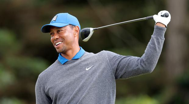 Tiger Woods has agreed a deal to write a memoir (Richard Sellers/PA)