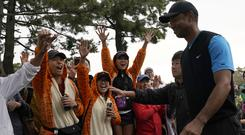 Tiger Woods holds a three-shot lead in the final round of the Zozo Championship (AP Photo/Lee Jin-man)