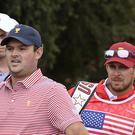 Patrick Reed (left) and his caddie Kessler Karain (AP)