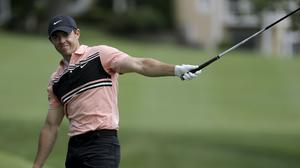Rory McIlroy, of Northern Ireland, watches his tee shot from the third hole during the first round of the Travelers Championship golf tournament at TPC River Highlands (Frank Franklin II/AP)