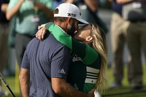 Dustin Johnson is hugged by Paulina Gretzky after winning the Masters (AP Photo/David J. Phillip)
