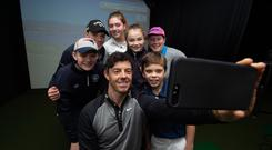 Selfie to treasure: Rory McIlroy with some of young golfers at the new state-of -the-art Holywood Academy