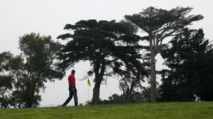 Tiger Woods walks to the 11th green during the final round of the PGA Championship (AP Photo/Jeff Chiu)