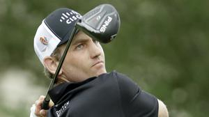 Brendon Todd watches his tee shot on the 18th hole during the third round of the World Golf Championship-FedEx St. Jude Invitational (Mark Humphrey/AP)