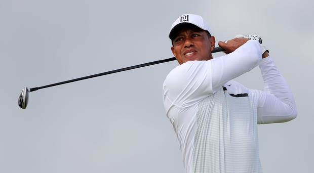 Tiger Woods' best efforts could not prevent the Internationals dominating (Richard Sellers/PA)