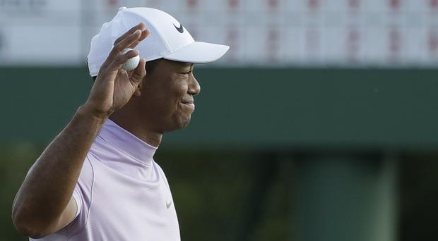 Tiger Woods is two shots off the lead heading into the final round of the Masters (AP Photo/Chris Carlson)