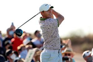 Pressure off: Rory McIlroy had his lowest round for two years at Scottsdale yesterday