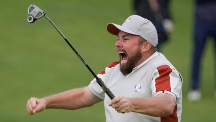 Team Europe's Shane Lowry celebrates on the 18th hole after winning his match with Tyrrell Hatton (Charlie Neibergall/AP)