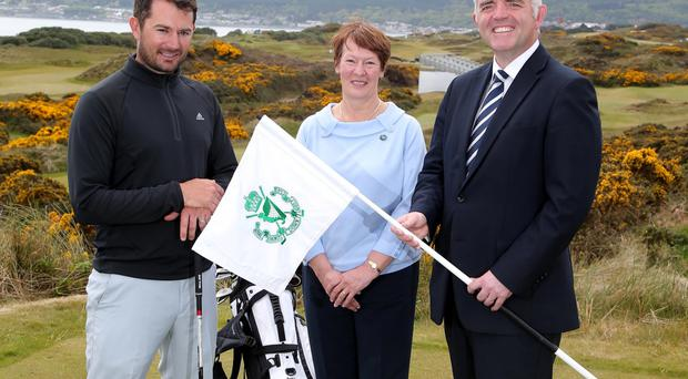 On course: Enterprise Minister Jonathan Bell with golfer Gareth Maybin and Tourism NI's Karen Hope