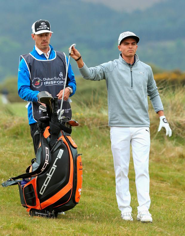 Clubbing together: Rickie Fowler and caddie Joe Skovron test out the Royal County Down course