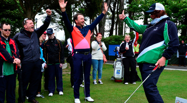 Thumbs up: Graeme McDowell celebrates with Margaret Carr of Ireland's Special Olympics team after she makes a put