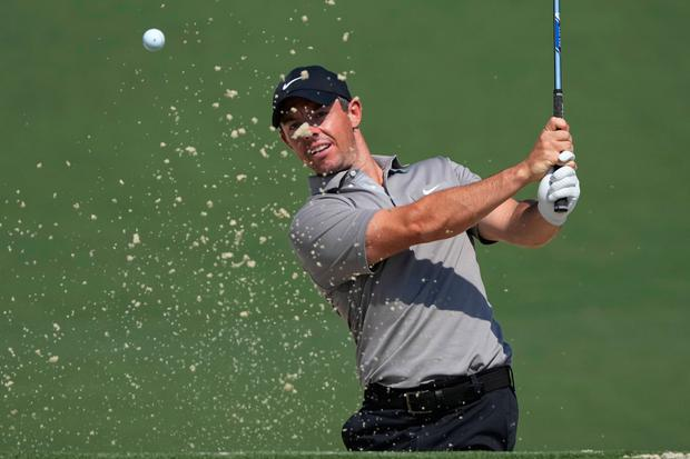 Rory McIlroy gets to grips with Augusta during a practice round ahead of his latest bid for Masters glory
