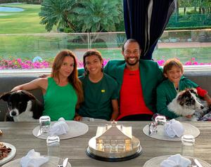 Woods from hosting his own version of the traditional Augusta Champions Dinner. On social media, he posted a picture of himself in his Green Jacket, with his children, Sam and Charlie, also decked in green, as well as his girlfriend, Erica and their two dogs. On the table sat the Masters Trophy. Woods's caption said: 'Masters Champions Dinner quarantine style. Nothing better than being with family'