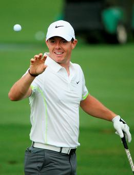Having a ball: Rory McIlroy was in a relaxed mood as he put the finishing touches to his practice round ahead of his bid to complete the Grand Slam at the Masters