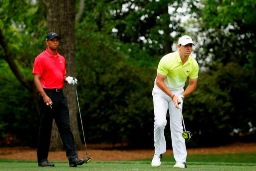 World's best: Rory McIlroy with Tiger Woods