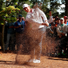 Pain and joy: Rory McIlroy plays a shot on the eighth