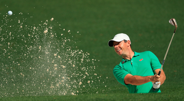 Looking up: Rory McIlroy plays out of a bunker during a practice round at Augusta ahead of the Masters
