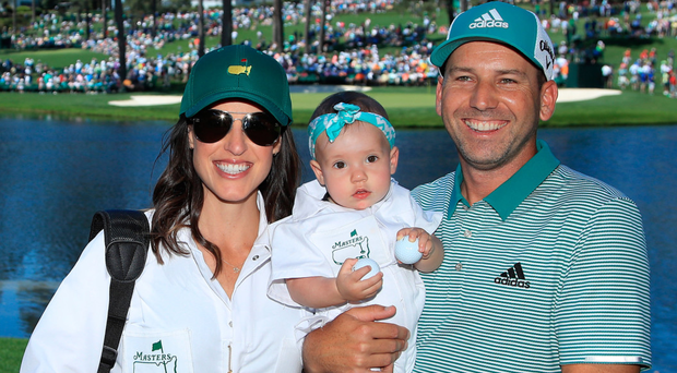 Child's play: Sergio Garcia with wife Angela and daughter Azalea at yesterday's Par 3 tournament at Augusta