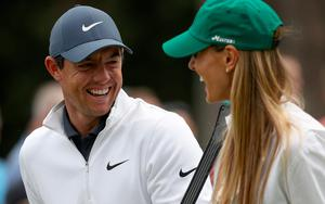Relaxed mood: Rory McIlroy with his wife Erica at Augusta