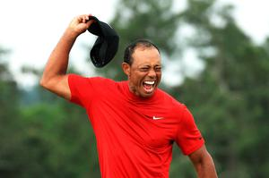 Tiger Woods celebrating victory again a year ago