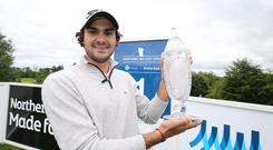 Prize guy: Clement Sordet shows off the NI Open title at Galgorm Castle