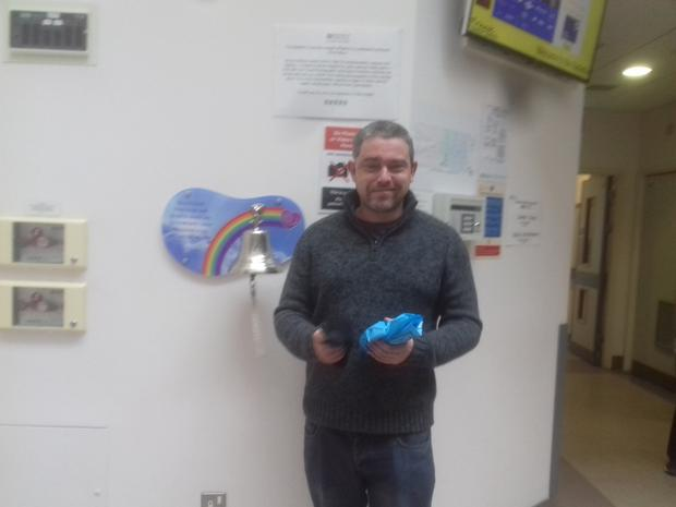 Chris Murray rings the cancer bell after treatment
