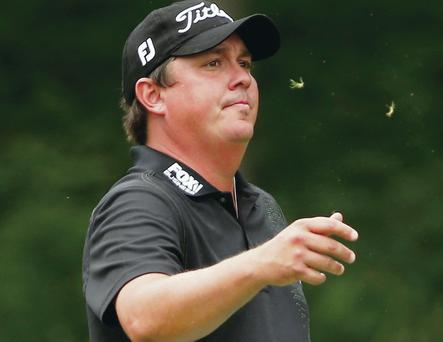 Withdrawal: Jason Dufner was forced to pull out of his defence of the US PGA during his first round with a troublesome neck injury