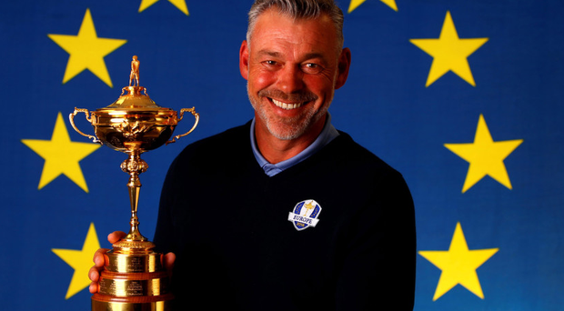 Star appeal: Darren Clarke poses yesterday as proud captain of the European Ryder Cup team