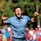 Roarin' Rory: McIlroy shouts out after sinking a 60ft putt at the eighth hole