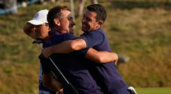 Big grins: Poulter and McIlroy