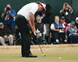 Phil Mickelson of the United States holes a birdie putt on the 18th hole during the final round of the 142nd Open Championship at Muirfield on July 21, 2013 in Gullane, Scotland.