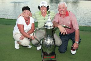 Rory with dad Gerry and mum Rosie after his first professional tournament win at the Dubai Desert Classic in 2009