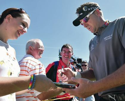 Write stuff: Ian Poulter signs autographs for fans at Royal Liverpool yesterday ahead of the Open which starts tomorrow