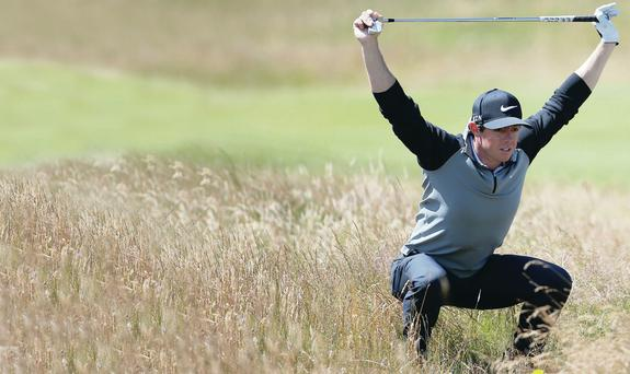 At a stretch: Rory McIlroy limbers up for the Open at Hoylake yesterday