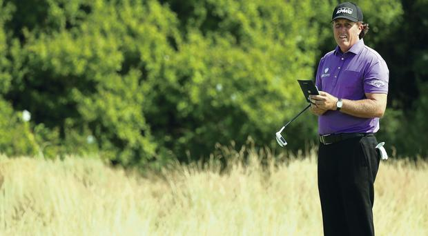 Looking lost? Phil Mickelson had an indifferent first round but has no intention of throwing in the towel just yet